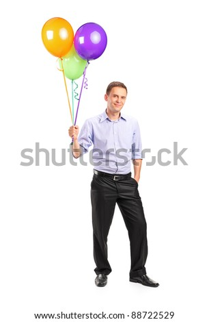 Full length portrait of a smiling man holding balloons isolated on white background