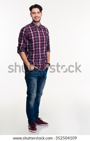 Full length portrait of a smiling man standing isolated on a white background and looking at camera - stock photo