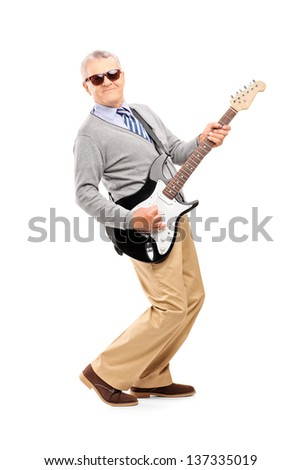 Full length portrait of a smiling mature man playing guitar isolated on white background
