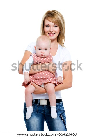 Full-length portrait of a smiling mother with baby on hands -   isolated on white - stock photo