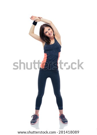 Full length portrait of a smiling sporty woman doing stretching exercise isolated on a white background. Looking at camera - stock photo
