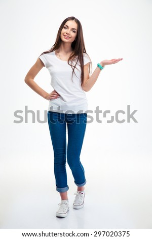 Full length portrait of a smiling woman holding copyspace on the palm isolated on a white background. Looking at camera - stock photo