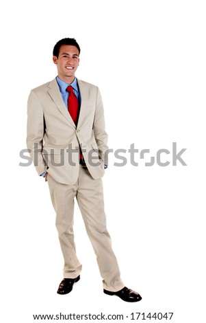 Full length portrait of a smiling young businessman standing against isolated white background - stock photo