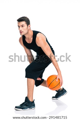 Full length portrait of a sports man playing in basketball isolated on a white background - stock photo