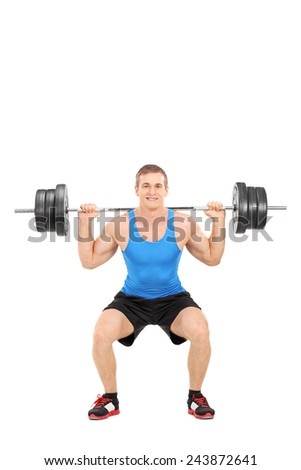 Full length portrait of a strong man exercising with a barbell isolated on white background - stock photo