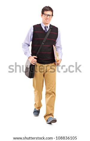 Full length portrait of a student walking with notebooks in his hand isolated on white background - stock photo