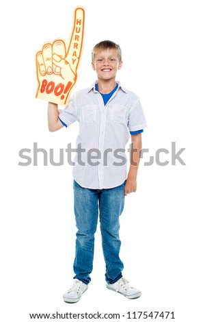 Full length portrait of a stylish young boy wearing a large foam hand. Boo and hurray! - stock photo