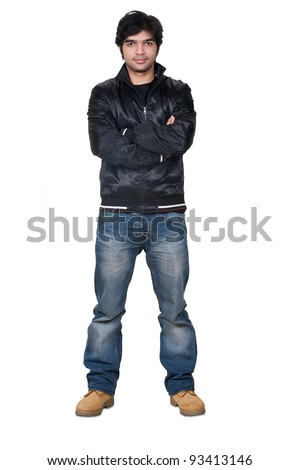 full length portrait of a stylish young Indian man - stock photo