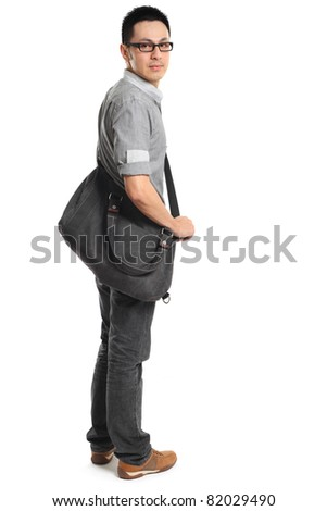 Full length portrait of a stylish young man standing and holding a bag. Isolated on white background. - stock photo