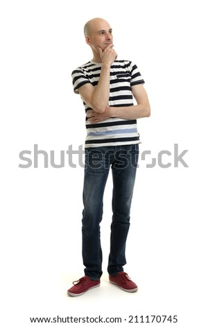 Full length portrait of a stylish young man standing over white background - stock photo