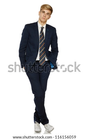 Full length portrait of a stylish young man standing posing in suit over white background