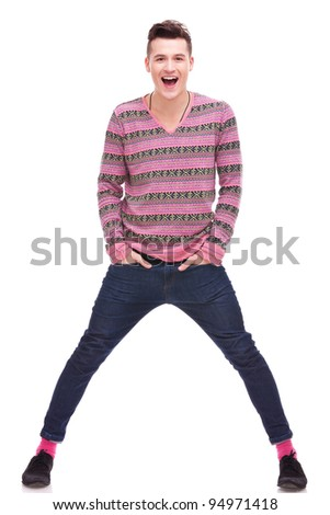 Full length portrait of a stylish young man standing with hands in pockets over white background . young casual manwith his hands in pockets smiling to the camera with excitement - stock photo