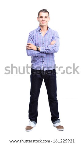 Full length portrait of a stylish young man with arms crossed and satisfaction