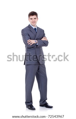 Full length portrait of a successful business man with hands folded isolated on white - stock photo