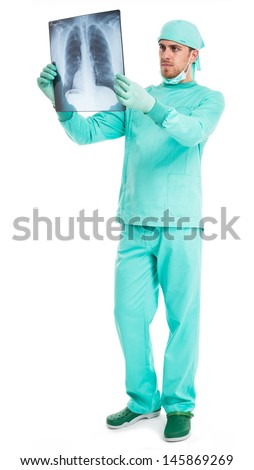 Full length portrait of a surgeon examining a radiography - stock photo