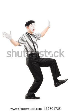 Full length portrait of a surpised mime artist gesturing with hands, isolated on white background - stock photo