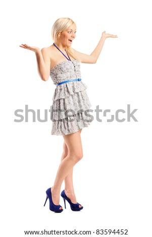 Full length portrait of a surprised young woman with hands over her isolated against white background - stock photo
