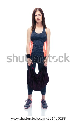 Full length portrait of a tired cute woman standing with sports bag isolated on a white background. Looking at camera - stock photo
