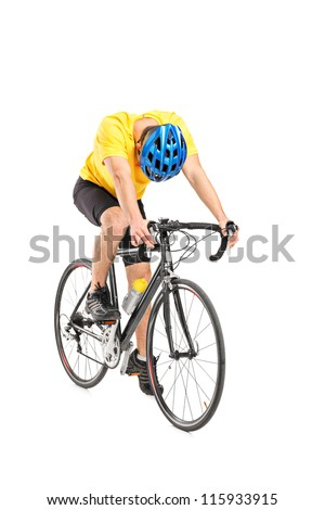 Full length portrait of a tired cyclist on a bicycle isolated against white background - stock photo