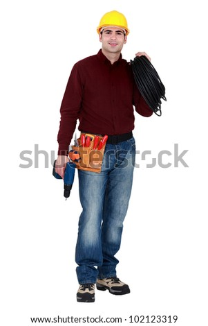 Full-length portrait of a tradesman - stock photo
