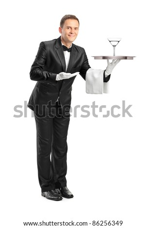 Full length portrait of a waiter holding a tray with a glass of cocktail on it isolated on white background - stock photo