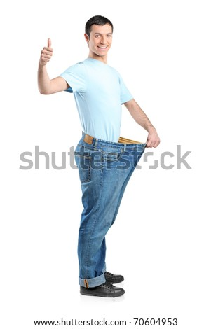 Full length portrait of a weight loss male with thumb up isolated on white