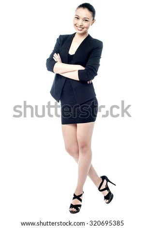 Full length portrait of a woman in business attire - stock photo