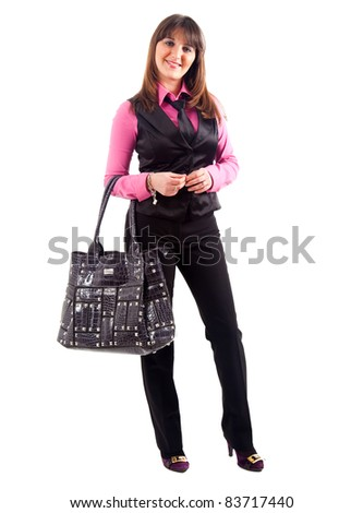 Full length portrait of a woman in casual cloths holding a bag - stock photo