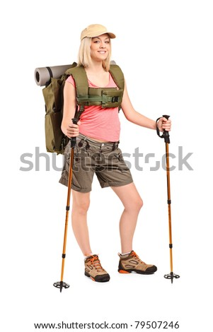 Full length portrait of a woman in sportswear with backpack and hiking poles isolated on white background