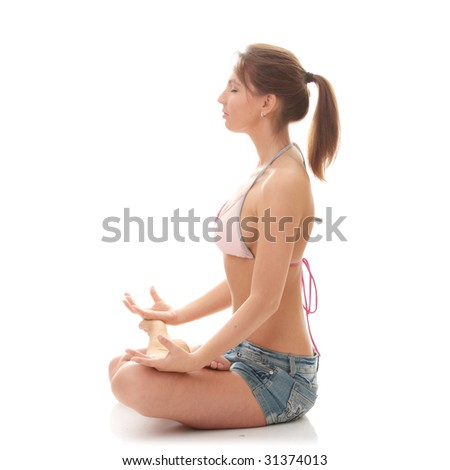 Full length portrait of a woman meditating on isolated white background - stock photo