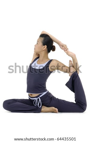 Full length portrait of a woman practicing yoga