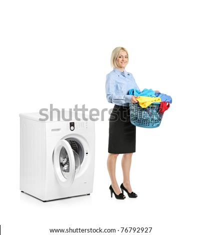 Full length portrait of a woman standing next to a washing machine isolated on white background - stock photo