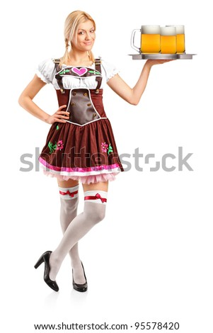 Full length portrait of a woman wearing traditional costume and holding three beer glasses isolated on white background - stock photo