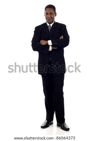 Full length portrait of a young African American businessman standing with his hands crossed isolated white background - stock photo