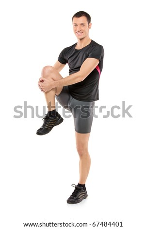 Full length portrait of a young athlete exercising isolated on white background - stock photo