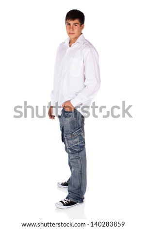 Full length portrait of a young attractive handsome caucasian male model wearing jeans and a white button shirt isolated on a white background