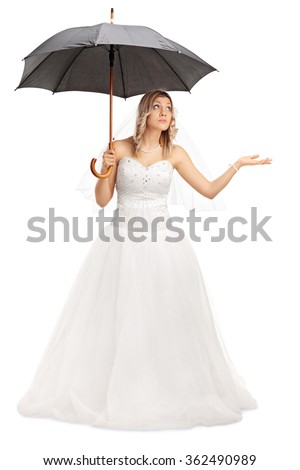 Full length portrait of a young bride in a white wedding dress holding an umbrella isolated on white background - stock photo