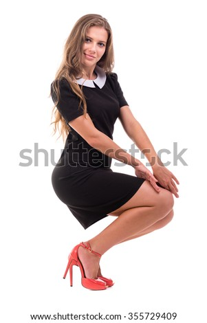 full-length portrait of a young business woman, isolated on white background - stock photo