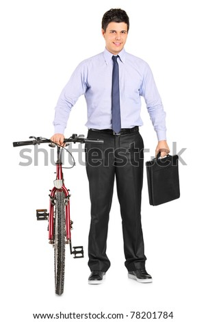 Full length portrait of a young businessman posing next to a bicycle isolated on white background - stock photo