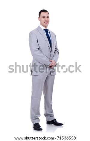 Full length portrait of a young businessman standing on white background