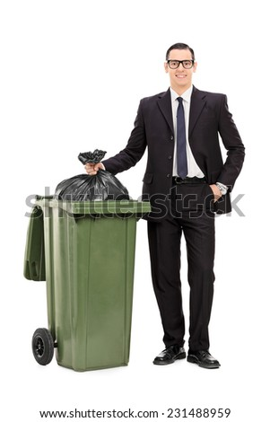 Full length portrait of a young businessman taking out the trash isolated on white background - stock photo