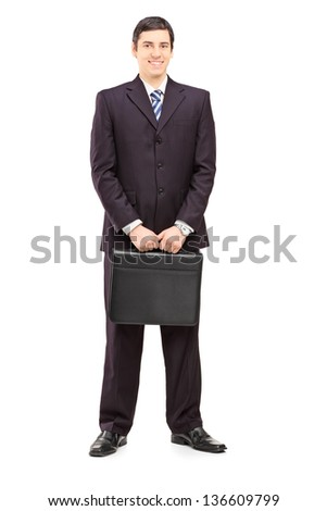 Full length portrait of a young businessman with a briefcase posing isolated on white background - stock photo