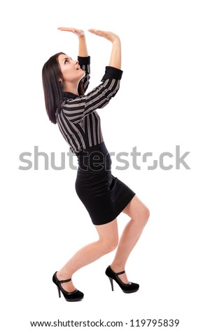 Full length portrait of a young businesswoman crushed by an invisible large object, insert your text or design above