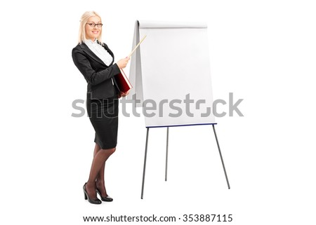 Full length portrait of a young businesswoman pointing on a blank presentation board with a wooden stick and looking at the camera isolated on white background - stock photo