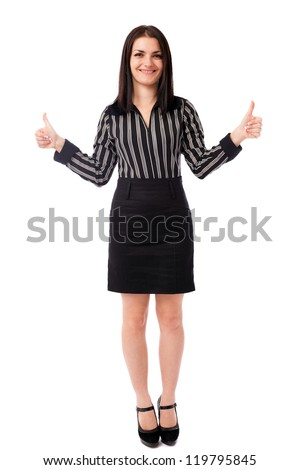 Full length portrait of a young businesswoman showing thumbs up isolated on white background