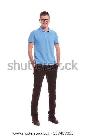 full length portrait of a young casual man standing with his hands in his pockets and smiling for the camera. on white background - stock photo