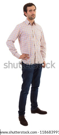 Full length portrait of a young caucasian man with hand on hips - stock photo