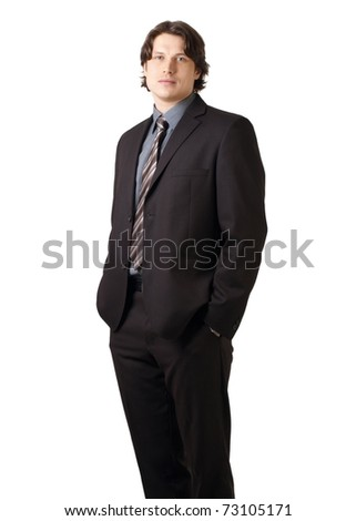Full length portrait of a young confident businessman standing with his hands in the pockets, isolated on white - stock photo