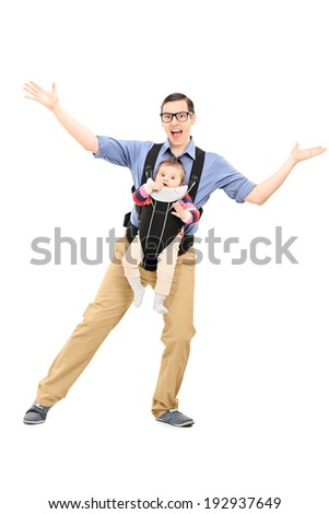 Full length portrait of a young father dancing and carrying his baby daughter isolated on white background - stock photo