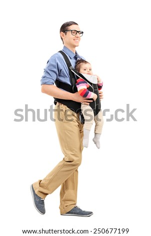 Full length portrait of a young father with his daughter walking isolated on white background - stock photo